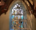 Chapel stained glass windows installation behind the Altar. by Dale Ward