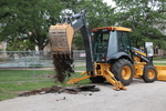 Dale Meyer, Seminary President, using a backhoe during the groundbreaking for the library renovation.