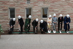 The ceremonial shoveling of dirt during the groundbreaking for the library renovation.